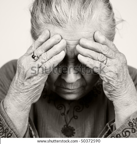 Unhappy old senior woman with health problems - stock photo