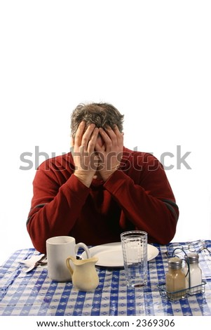 Unhappy or tired man in cafe - stock photo