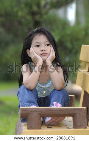 Unhappy sad little girl - stock photo