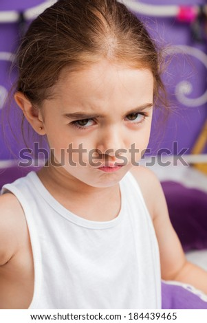 unhappy sad little girl, stressed face, upset child at home, concept of teenage stress and problems, depressed - stock photo