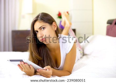 Unhappy sad woman tired of working on internet - stock photo