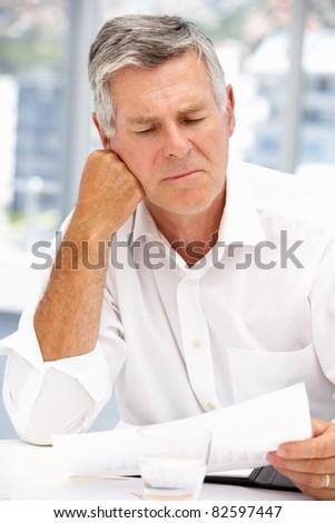 Unhappy senior businessman - stock photo