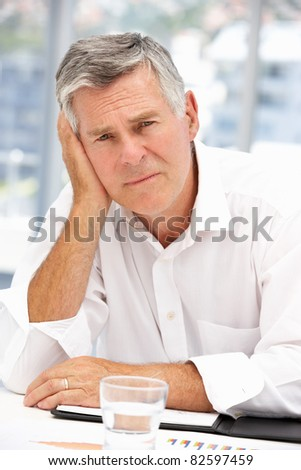 Unhappy senior businessman