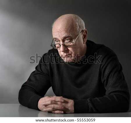 Unhappy senior man - stock photo