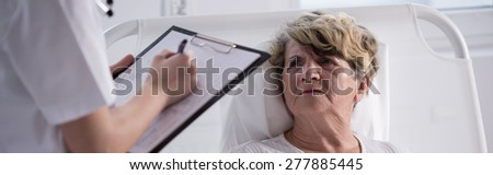 Unhappy senior woman staying in hospital - panorama - stock photo