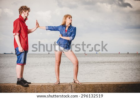 Unhappy upset angry woman refuses apology. Boyfriend trying to convince girlfriend. Man asking for forgiveness. Conflicted couple. Relationship problem - stock photo