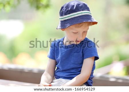 unhappy upset little boy looking away - stock photo