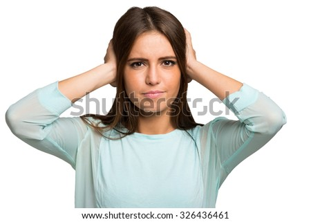 Unhappy woman closing her ears with the hands. - stock photo