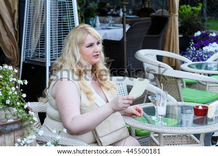unhappy  woman eating food in restaurant