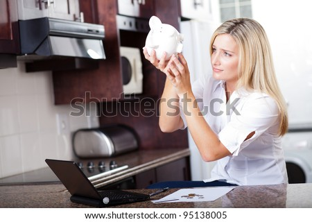 unhappy woman has no more money left to pay bills - stock photo