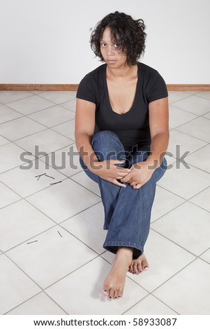 Unhappy woman, perspective from above - stock photo