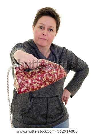 unhappy woman receiving an unwanted Christmas present in the shape of an iron. White background portrait with copy space. - stock photo