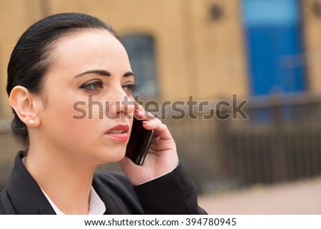 Unhappy Woman Using Cell Phone