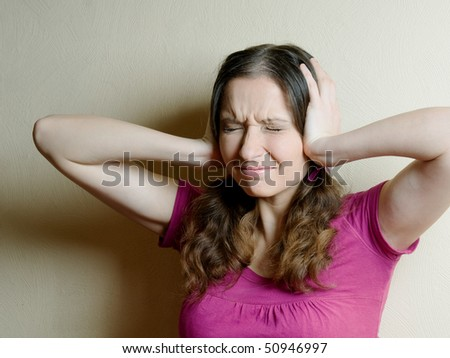 unhappy  woman with hands on ears - stock photo