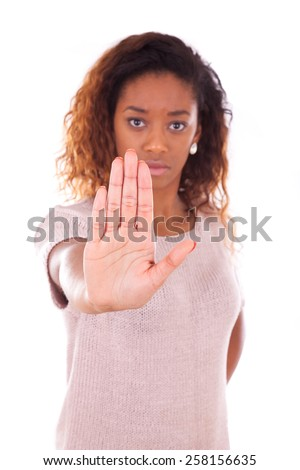 Unhappy young african american making stop sign with her hand palm isolated on white background - stock photo
