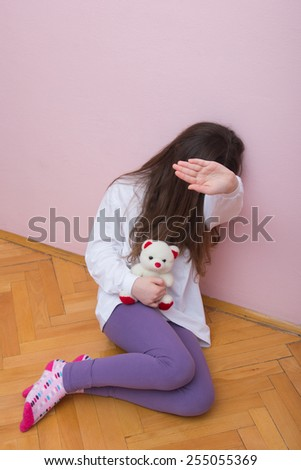 Unhappy Young Girl. Concept: Domestic and Family Violence. Abuse Child. - stock photo