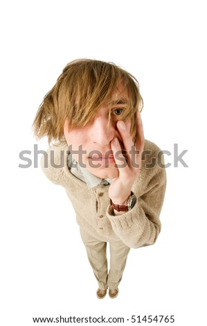 Unhappy young man isolated on white background. Fisheye lens. - stock photo