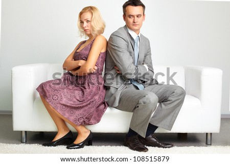 Unhappy young woman crossing her arms after the quarrel with her husband - stock photo