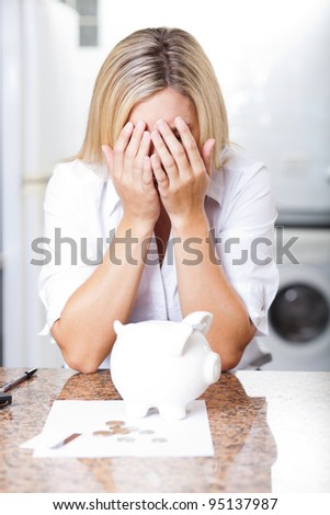 unhappy young woman having financial trouble - stock photo