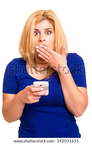 Unhappy young woman reading a text message in her cellphone - stock photo