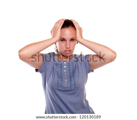 Unhappy young woman with a terrible headache standing over white background - stock photo