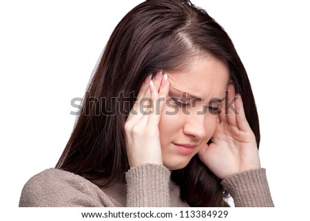 Unhappy young woman with bad headache on white background. Awful migraine - stock photo