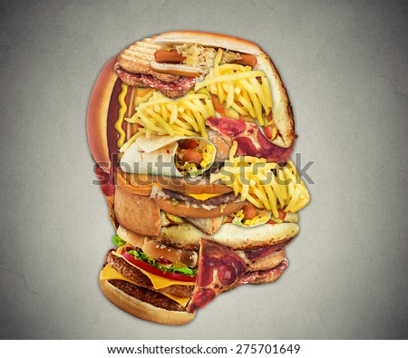 Unhealthy diet health concept with group of greasy fast food in shape of human head symbol of dangerous eating lifestyle and icon of addiction to bad nutrition and risk of heart disease. - stock photo