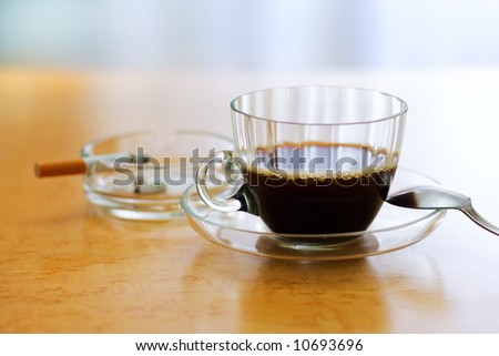 Unhealthy habits - strong coffee and cigarette - stock photo