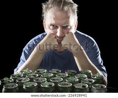 unhealthy view man after drunk, near empty beer container - stock photo