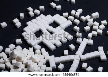 unhealthy white sugar concept on black background. Selective focus