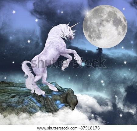 Unicorn over a rock - stock photo