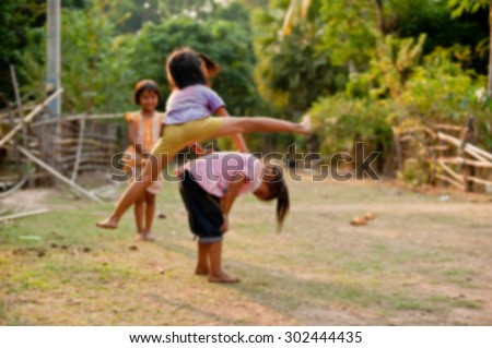 Unidentified Children of Laos play and fun of kids in countryside village on Champasak, Laos, blur background - stock photo