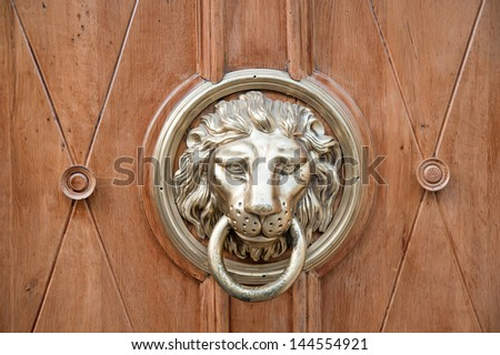 Unidentified lion head door knocker