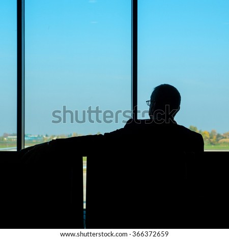 Unidentified man waiting at the airport.  - stock photo