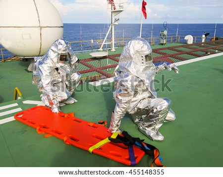 Unidentified offshore people practice rescue casualty drill at the offshore. - stock photo