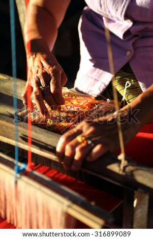 Unidentified old women weaving traditional thai fabric, Chiang Mai, Thailand.