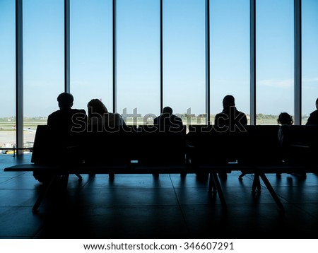 Unidentified people waiting at the airport.  - stock photo