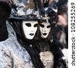 Unidentified persons in Venice mask at St. Mark's Square, Carnival of Venice on February 12, 2012. - stock photo