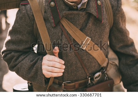 Unidentified re-enactor dressed as Soviet soldier. Close up of soviet military decoration on uniform of a Russian soldier. - stock photo