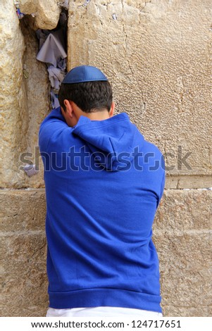 Unidentified  worshiper  pray at the Wailing Wall an important jewish religious site   in Jerusalem, Israel. - stock photo