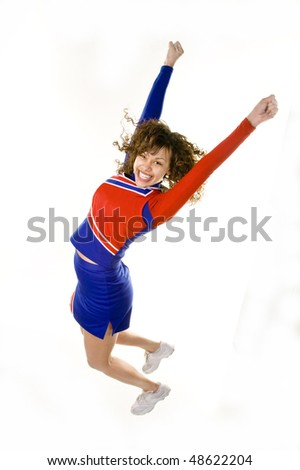Uniformed cheerleader jumps high in the  air isolated on white. - stock photo