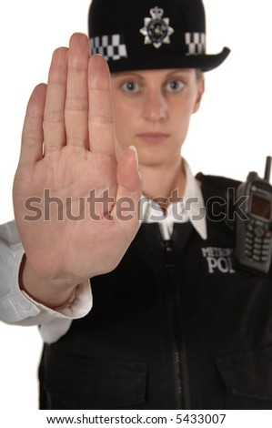 Uniformed UK female police officer with hand up showing stop isolated on white focus on hand - stock photo