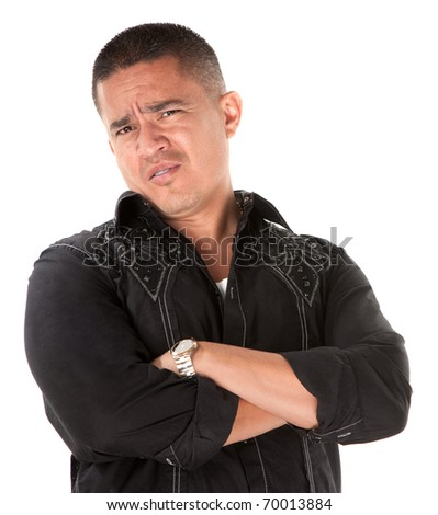 Unimpressed or offended Native American with folded arms on white background