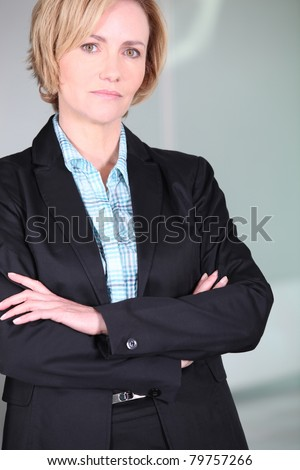 Unimpressed woman with her arms folded - stock photo