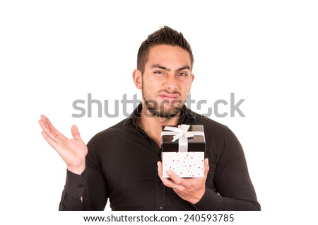 unimpressed young man holding a gift box isolated on white