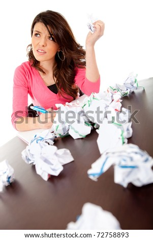 Uninspired female student attempting to write an essay - stock photo