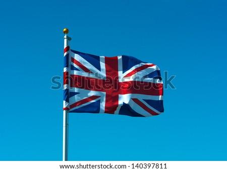 Union flag flying on flagpole - stock photo