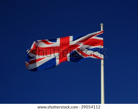 Union flag of Great Britain flying against a blue sky