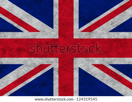 Union flag on a grunge concrete wall background - stock photo