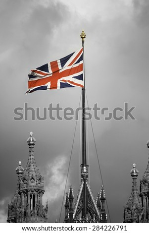 Union Jack flag waiving in the wind  - stock photo
